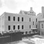 O-School dormitory building construction completed in 1951